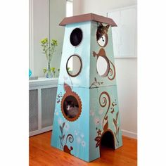 This artistic cardboard tower, with a full color print, has multiple levels for…