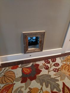 I cut a hole in my hallway that goes to the garage and bought a frame to match my decor