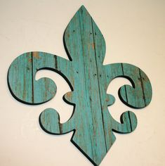 Add this Shabby Chic Fleur de lis wall art to the ledge in the dining room. The shape will break up the framed pieces.