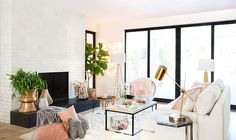 Mixed metals, and soft pinks for this bright living room.