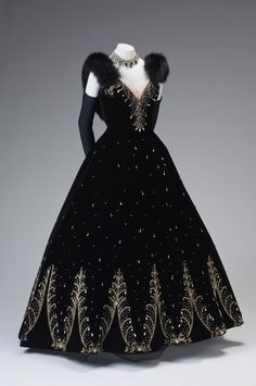 Embroidered black silk velvet ball gown with rhinestone embellishment and fox fur trim, by Philip Hulitar, American, c. 1950-55.