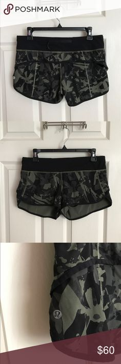 Lululemon Camo Shorts These are lululemon athletica camo shorts in a green and black color scheme. This is a rare color/design! Great condition! The only flaw is that there is a tiny section in the back about an inch or so long that has some pilling but it's completely unnoticeable when worn. Size 6. lululemon athletica Shorts