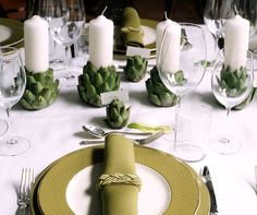 Artichoke candle holders with white pillar candles~ Place in hurricane lamp candle holder for buffet centerpiece.