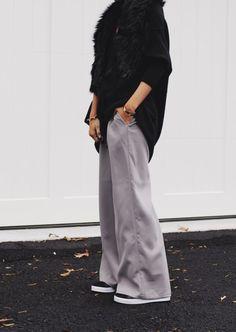 grey wide leg pants, black leather sneakers street style
