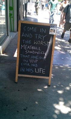 Funny sidewalk sign invites you to enjoy the worst meatball sandwich ever...