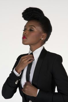 I'll take this classy look all day.  She's gorgeous......Janelle Monae