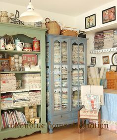 great storage for fabrics i like the glass cased fabrics shelves lined with lace all the craft books on bottom shelf of green bookcase and other craft nik naks