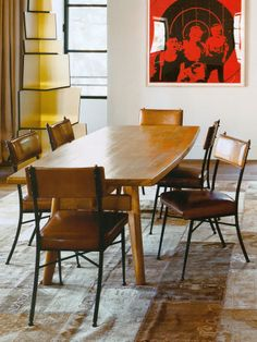 Colorful dining room with leather dining chairs.