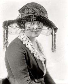 "Fashionista: 1915. Washington, D.C., circa 1915. ""Miss Elsie Walker."" Whose fetching features are only enhanced by her chic chapeau. Harris & Ewing."