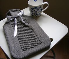 Hand knit bobble effect hotwater bottle by strikk on Etsy, £35.00 // I used to sell something similar on Etsy...