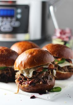 The homemade barbecue sauce that coats the pulled chicken in these slow-cooker blackberry jalapeno chicken burgers is just the right balance of sweet and spicy.