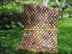 Agulhas e Pinceis: Tapete de lã bordado sobre tela