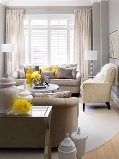 (Maybe try with other color combos) In the living room: Here the yellow throw pillows are just like that small vase of fresh blossoms, adding just the right touch of yellow to this soft and sophisticated room.note the earth tone neutrals