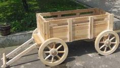 Proven to stimulate high profits, these carts and wagons will do the same for your store. Wooden carts and wagons are the most attractive store fixtures. Wagon Planter, Wheelbarrow Planter, Wood Cart, Wooden Wagon, Diy Garden Furniture, Wooden Planters, Wooden Garden, Wood Display, Garden In The Woods