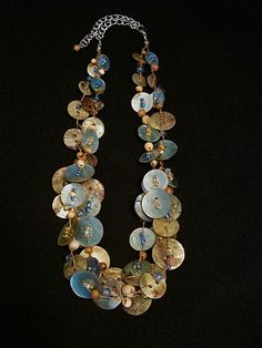 Lovely Button Necklace ` 49 polished MOP buttons.