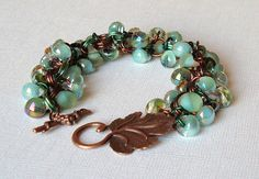 Items similar to Shaggy loops bracelet with green Unicorne beads and leaf toggle on Etsy