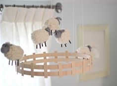 This sheep mobile (Pottery Barn Kids) really adds a touch of whimsy to the room. I love the 'hand-made' looking quality it has. Light Blue Nursery, Cream Nursery, Nursery Neutral, Mobiles, Sheep Mobile, Sheep Nursery, Baby Lamb Nursery, Baby Sheep, Diy Bebe