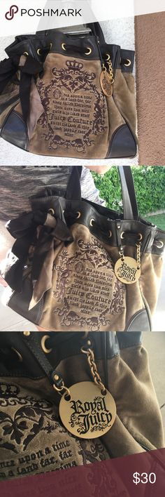 Adorable juicy Cotoure bag Adorable juicy bag for sale. This bag has a few signs of normal wear and tear, but is overall in great condition Juicy Couture Bags Shoulder Bags