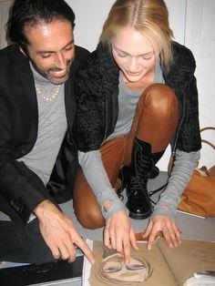 Designer Giambattista Valli with his Russian model and artist Sasha Pivavora on the backstage.