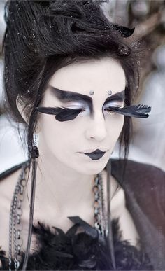 Raven makeup, so amazing. I wonder if the model had to shave her eyebrows to get this effect.