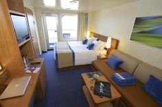 Although stateroom 7405 features a sleeper sofa, I would not recommend this room for a family (the maximum allowed is three people). However, 7405 does adjoin with the room next door, so combining the two could be a good option or opting for a suite. Otherwise, for a solo traveler or couple, I found 7405 to be spacious, attractive and smartly functional, with three closets, a desk for work or applying makeup — and a balcony with generous space. © 2012 Ralph Grizzle avidcruiser.com