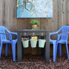 Eat, learn, play, color and draw at this super simple and super cute DIY kids table made from an end table! I love the buckets hanging from the table
