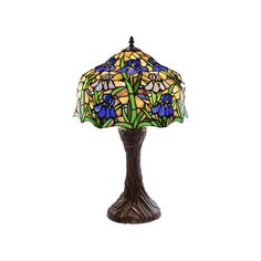 This elegant Iris Table Lamp has been handcrafted using methods first developed by Louis Comfort Tiffany.