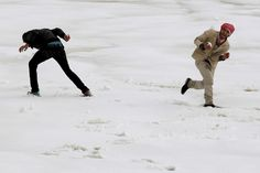 YOUNG AT HEART: Men played in the snow after a heavy snowstorm in Amman, Jordan, Wednesday. Inclement weather caused the closure of main streets in the capital and other cities. (Muhammad Hamed/Reuters)