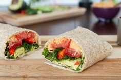 Kitchen Sink Veggie Wrap (with Red Lentil Hummus and green onion, tomato, avocado, kale, red pepper, pea shoots) from Oh She Glows #vegan
