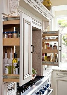 Instead of cupboards to make a recessed cooker, use large drawers and put the oils, herbs and spices there for easy access.