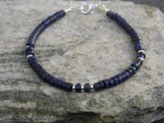 Mens or womens Lapis Lazuli heishi bracelet, with sterling silver heishi spacers. This bracelet was created with high quality natural lapis stones that have a somewhat rough cut and a rustic finish, in between matte and gloss. The beads are 5mm wide (about 1/4 inch) and the bracelet pictured is 8 inches long, just tell me your exact wrist size above. Thank you for stopping in! To see more go to: BraidedSouls.etsy.com   o/