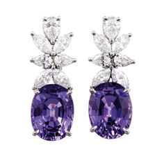 A PAIR OF SAPPHIRE AND DIAMOND PENDANTEAR PENDANTS, BY TIFFANY & CO. Each suspending an oval-shaped sapphire, altogether weighing approximately 6 carats, surmounted by marquise-cut diamonds, mounted in platinum, signed Tiffany & Co.
