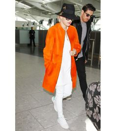 @Who What Wear - Rita Ora                 The quickest way to a noteworthy en-route ensemble is a bright coat, as demonstrated by Rita Ora at Heathrow Airport last week. Teamed with all-white separates, the singer's neon orange was the centerpiece of her look.