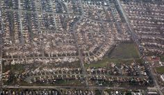 This aerial photo shows the remains of homes hit by a massive tornado in Moore, Okla., Monday May 20, 2013. A tornado roared through the Oklahoma City suburbs Monday, flattening entire neighborhoods, setting buildings on fire and landing a direct blow on an elementary school. (Steve Gooch / AP)