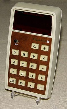 Vintage Texas Instruments Exactra 21 Electronic Pocket Calculator, Model EX-21, Red LED Display, Made In USA, Circa 1974.
