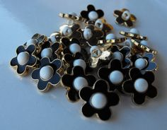 11 Gold with Black Petal Flower Shanked Buttons by AJStuff on Etsy, $2.50