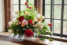 Wedding ceremony/ table arrangements of English wedding in Tudor Barn. Red. nude and pink roses in rustic style. Rustic wedding, nature inspired.
