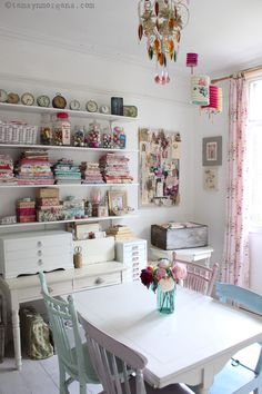 A Creative Space - my craft studio features painted furniture and open shelves to display my collection of vintage fabrics.