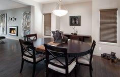 Dinning Room/Flex Room in the Arlington III Showhome - dark woods and white walls