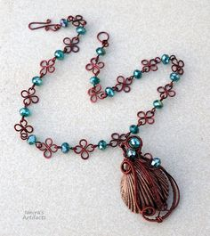 Copper coloured seashell wire wrapped necklace by IanirasArtifacts