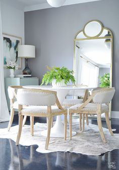 mid centry modern dining space white tulip table 48 gold brass floor mirror cow hide rug zdesign at home summer home tour 2017-1