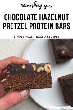 Vegan Chocolate Hazelnut Pretzel Protein Bars | Nourishing Yas - Simple Plant based Recipes #veganrecipes #veganprotein #proteinbars #vegandesserts #veganchocolate #pretzels #chocolatehazelnut #healthyrecipes #nobakedesserts