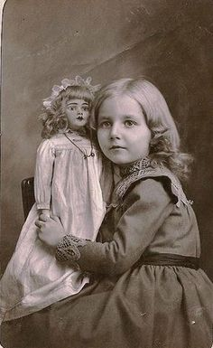 Pretty girl with doll