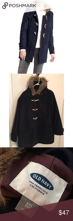 Beautiful thick winter coat Navy blue thick winter coat with faux fur hood & three buttons down the front! The coat has a zipper under the buttons, so it can be worn unbuttoned as well. Also, there is an optional chin strap for added warmth! Brand new, flawless condition! Old Navy Jackets & Coats Pea Coats
