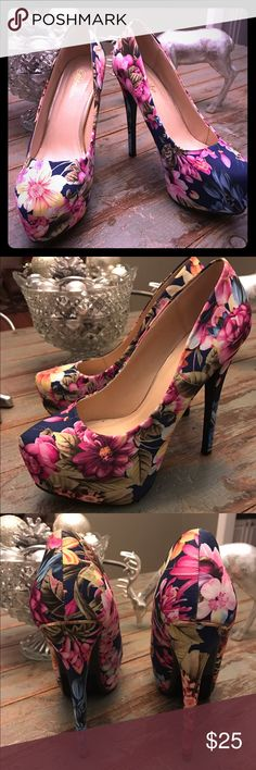 Paprika Blue Flowered Platform Stilettos Paprika Flowered platform pumps - so pretty! Cobalt blue background with bright pink, yellow and blue flowers with green leaves. Pointed toe and cushioned insoles. Nonslip bottoms. Worn once!                                      Heel height: 6 in. Platform: 2 in. Paprika Shoes Heels
