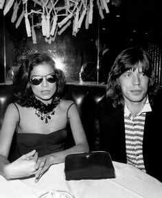 Bianca (fierce) and Mick Jagger in a booth at The Copacabana, 1976.