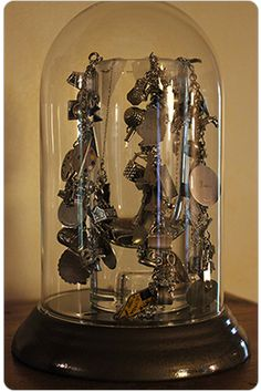 displaying favorite jewelery under cloche attractive idea.....could also display favorite perfume bottles....