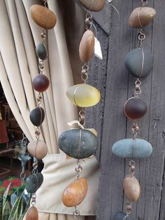 Dont you love these rain-chains? Made using found pebbles, glass and other pretty thingies, wrapped in wire, hooked together and hung from the gutter. I think they are pretty just as a decoration. You could add sea glass and other sparkly things too