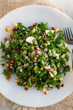 NYT Cooking: I was going to call this a barley salad with parsley, dill and hazelnuts, but it is really a parsley salad, like a Middle Eastern tabouli. The relatively small amount of barley… Hazelnut Recipes, Vegetarian Recipes, Healthy Recipes, Lunch To Go, Everyday Food, Perfect Food, Soup And Salad, Salad Recipes, Kitchens