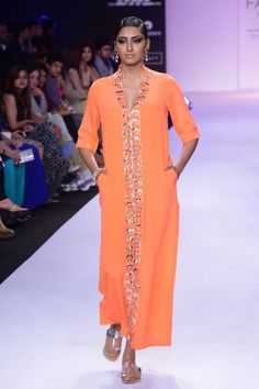 Orange embroidered kaftan dress available only at Pernia's Pop-Up Shop.